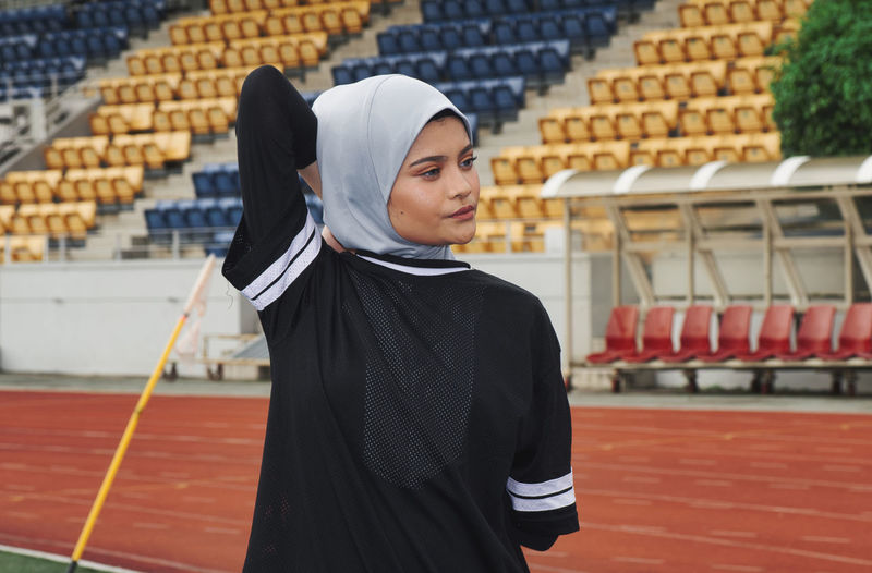 Athlete wearing hijab while exercising on sports track
