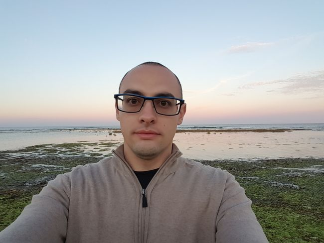 EyeEm Selects Beach Sea Water Horizon Over Water Summer Portrait Only Men One Person Sky Eyeglasses  Vacations Nature Front View Tranquility Adult Outdoors One Man Only Looking At Camera Real People Lifestyles Young Adult Sunset Eyeglasses  Beauty In Nature