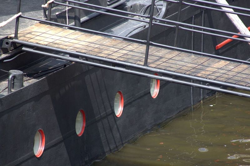 Black Boat Gangplank Marina Red Water