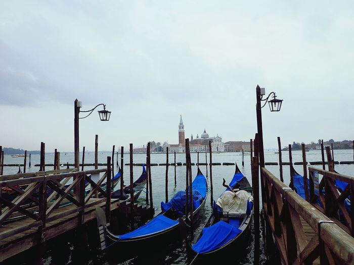 Gondolas on grand canal in city