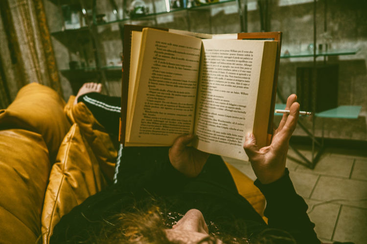 Rear view of people reading book