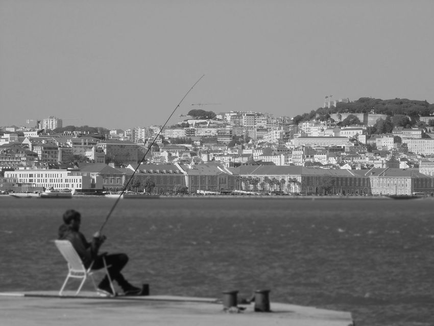 Castelo De São Jorge Lisboa Portugal Lisbon - Portugal Margem Sul, Portugal Adult Architecture Building Exterior Built Structure Cacilhas - Portugal Clear Sky Day Fishing Pole Leisure Activity Men Nature One Person Outdoors People Real People Sea Sitting Sky Water Women
