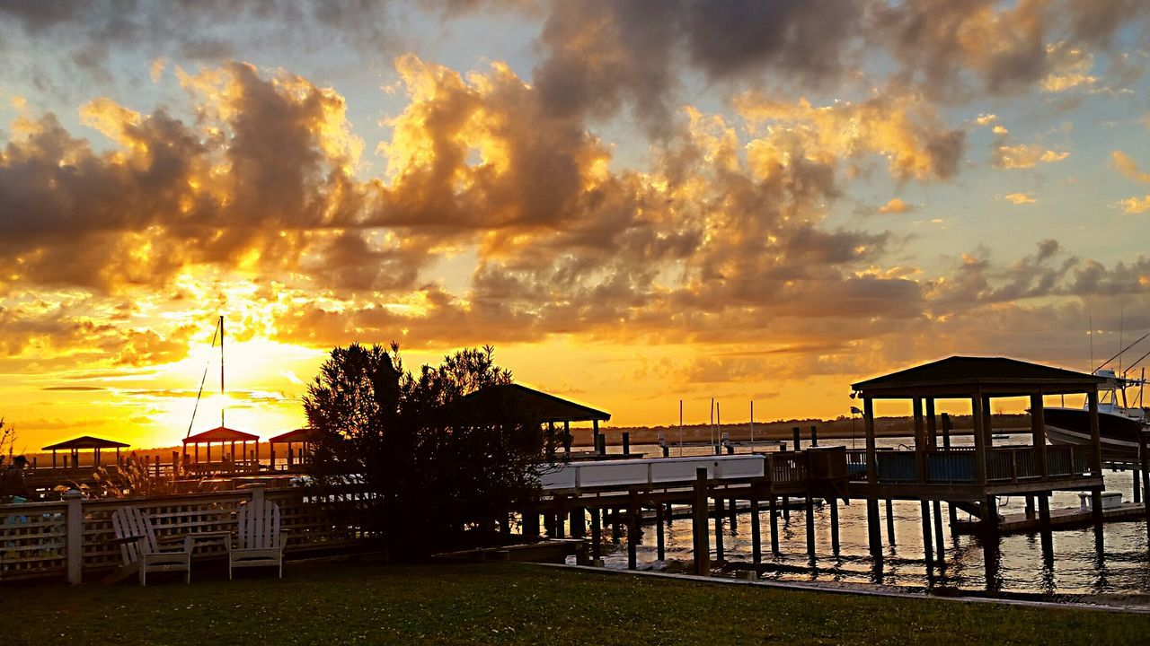 sunset, sky, built structure, cloud - sky, water, nature, tranquil scene, tranquility, silhouette, beauty in nature, architecture, scenics, outdoors, no people, building exterior, sea, beach, horizon over water, tree, day