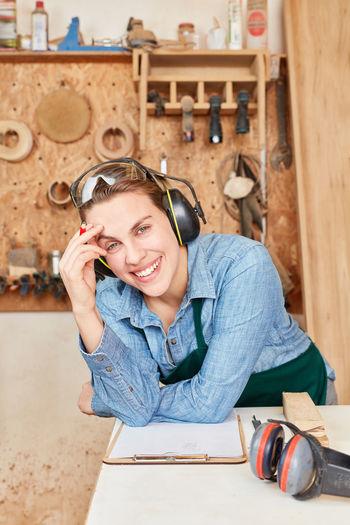 Portrait of smiling female carpenter at workshop