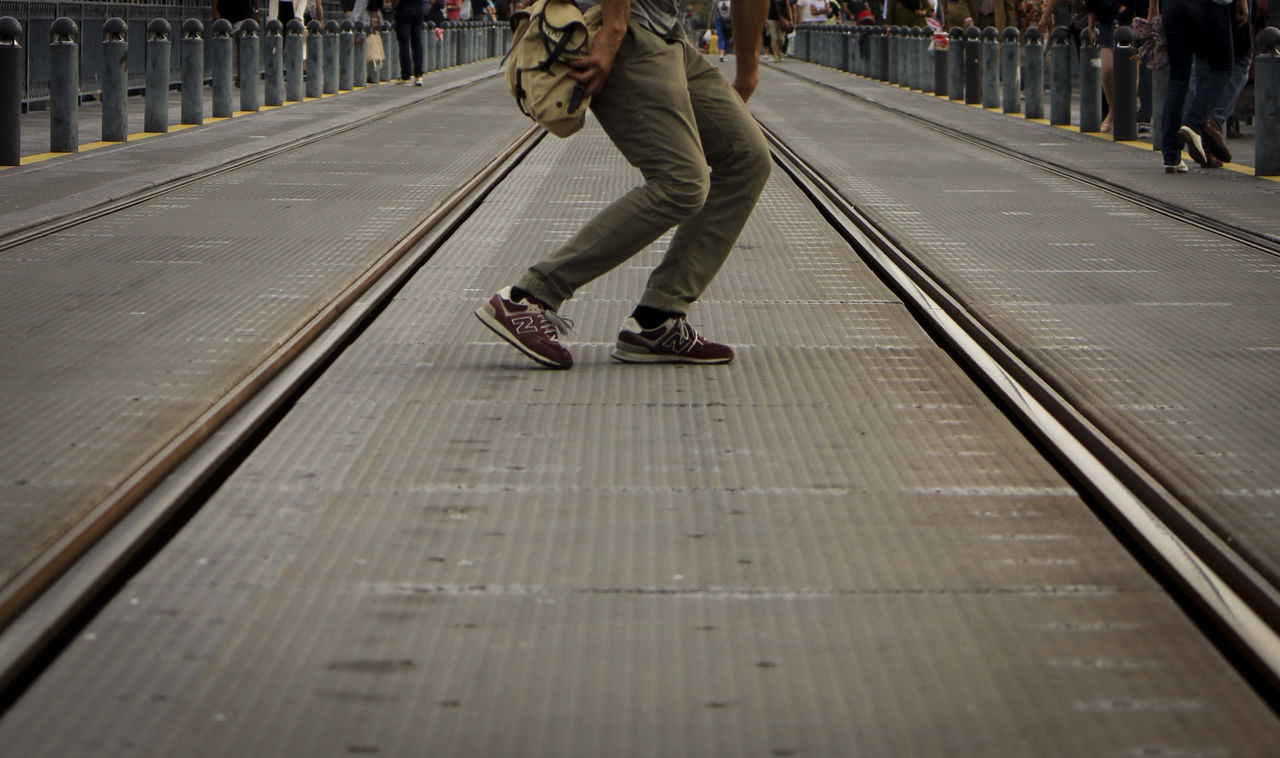 real people, railroad station platform, railroad track, transportation, rail transportation, public transportation, low section, men, one person, day, outdoors, adult, people