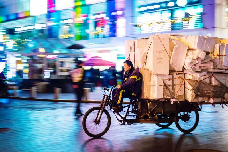 The Street Photographer - 2017 EyeEm Awards Real People Shanghai China Bicycle Motion Neon