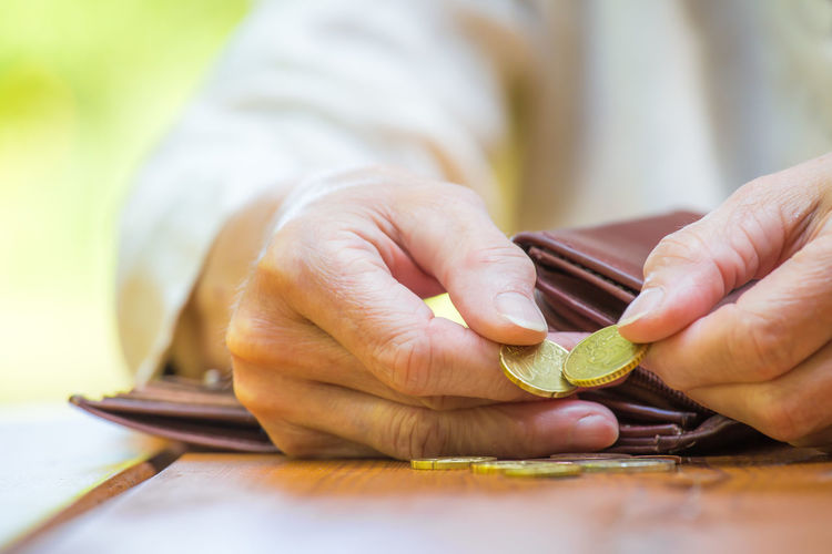 Midsection of woman counting coins
