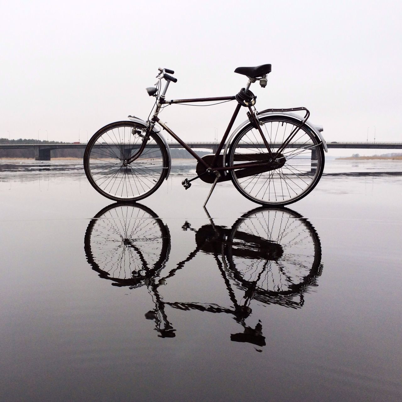 Bike reflected on water