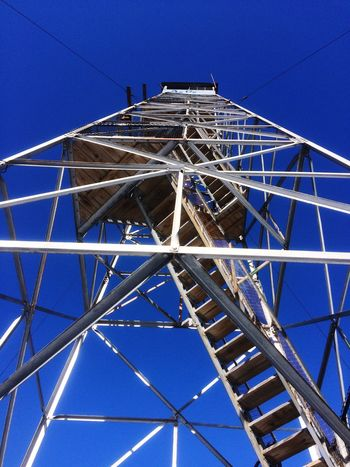 Fire tower. Blue Low Angle View Built Structure Clear Sky Architecture Outdoors Building Exterior No People Day Connection Sky Big Wheel Maine Hikingadventures Mountains Winter