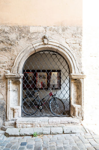 Entrance of old building. EyeEm Selects Bicycle Stationary Land Vehicle City Arch Bicycle Rack Architecture Building Exterior Built Structure #urbanana: The Urban Playground