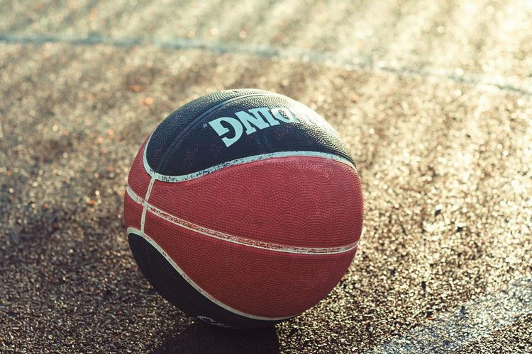 Basketball Basketball Sport Ball High Angle View Day No People Close-up Sunlight Shadow American Football - Sport Textured  Outdoors American Football - Ball Still Life Single Object Brown Red Focus On Foreground Leather Sports Equipment Competition