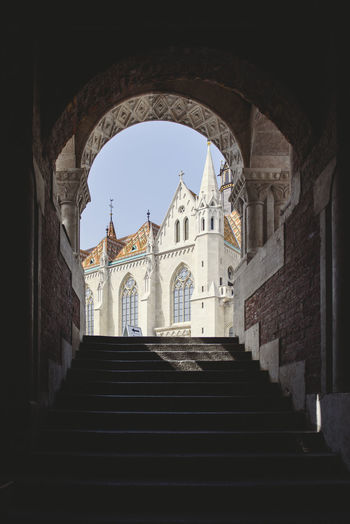 Original view of Matias church from downstairs in the Buda fishermen bastion, Budapest Arch Architecture Belief Building Building Exterior Built Structure Day Direction Low Angle View No People Outdoors Place Of Worship Religion Sky Spire  Spirituality Staircase Steps And Staircases The Past The Way Forward