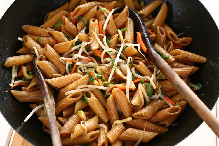 Asian Style Penne Rigate Asian Style Close-up Day Food Food And Drink Freshness Healthy Eating Indoors  No People Past Penne Italy Penne Rigate Sauteed Sautéed Pasta Soy Sauce Soy Sauce Pasta Wok Wooden Spoon Food Stories