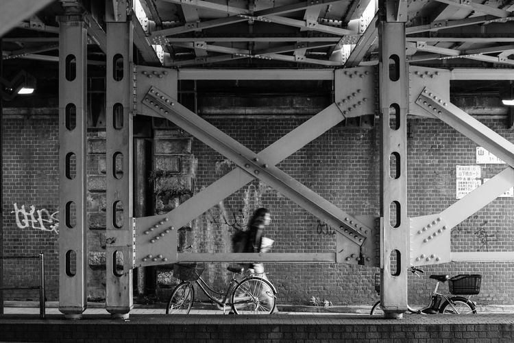 Architecture Bicycle Building Exterior Built Structure City Communication Day Land Vehicle Lifestyles Metal Mode Of Transportation Outdoors Real People Sport Text Transportation Western Script Wheel EyeEmNewHere