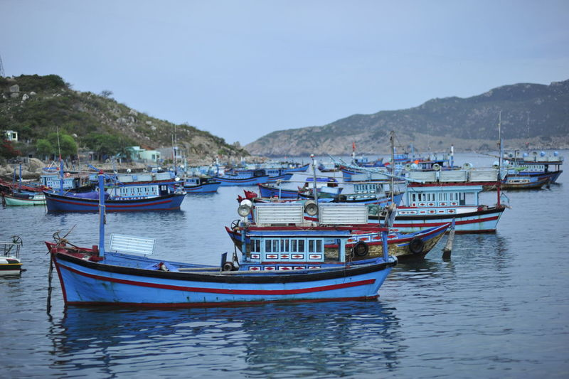 At Binh Hung island, Vietnam Great place for exploring BinhHung Fishing Town Life Nature Quiet Places Vietnamese Cloud - Sky Day Fishing Boat Floating On Water Hidden Beauty Island Landscape Landscapes Mountain Nature Nautical Vessel No People Ocean Outdoors Transportation Travel Destinations Travelphotography Village Life Water
