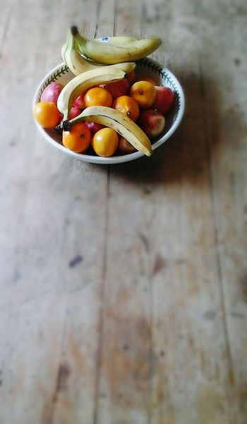 Composition In Orange And Yellow Composition Fruit Bowl And Kitchen Table. apples Satsumas Bananas Wooden Table Wooden Texture Wood Grain Texture StillLifePhotography