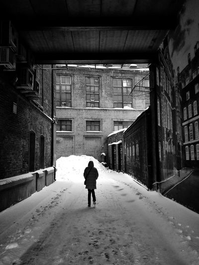 My Best Photo Streetphotography Bwstreetphotography Bwstreet Bnw Streetphoto_bw Urbanphotography Blackandwhite Full Length Snow Winter Cold Temperature Men Rear View Walking City Architecture Building Exterior