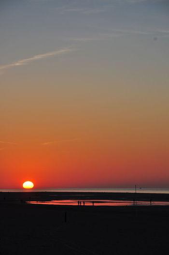 Sunset Ouddorp beach Tranquility Tranquil Scene Enjoying Life Hello World Nofilter Autumn Autumn colors Water Sea Sunset Beach Sand Low Tide Horizon Astronomy Sun Dramatic Sky Seascape