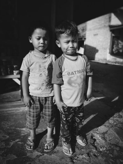 Full length portrait of cute siblings