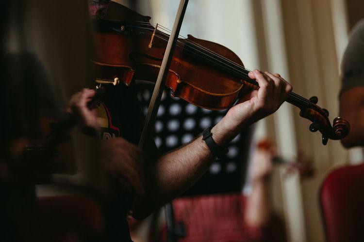 Close up musician playing violin
