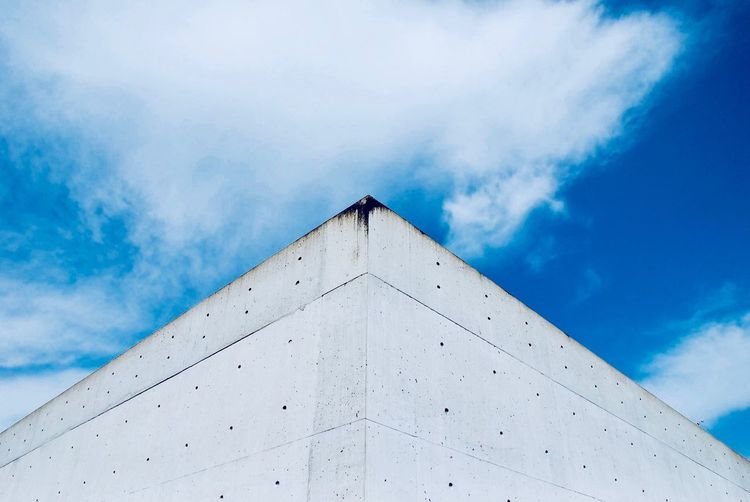 Wall and sky Pattern Pieces Sky And Clouds Clouds Wall - Building Feature Beton Wall EyeEm Selects Sky Cloud - Sky Architecture Low Angle View Built Structure Building Exterior No People Geometric Shape Triangle Shape Blue Shape Building The Still Life Photographer - 2018 EyeEm Awards The Architect - 2018 EyeEm Awards Capture Tomorrow