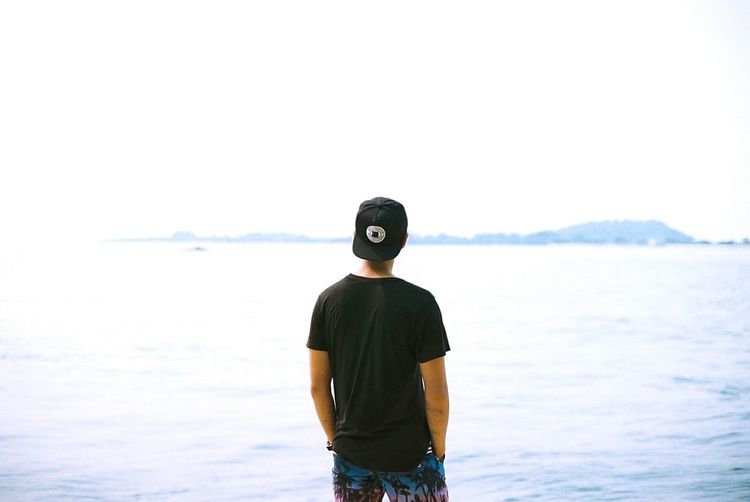 Young Man Standing On Shore