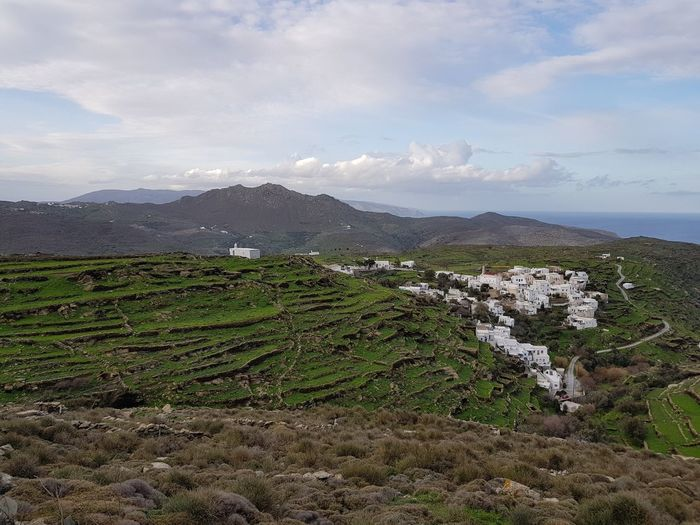 Agricultural terraced field and village Countryside Road Arid Landscape Mountain Mountain Range Village Thyme Chapel No People Outdoors Stone Wall Greek Islands Mediterranean Sea Agricultural Field Outdoors Water Sea Rural Scene Sky Landscape