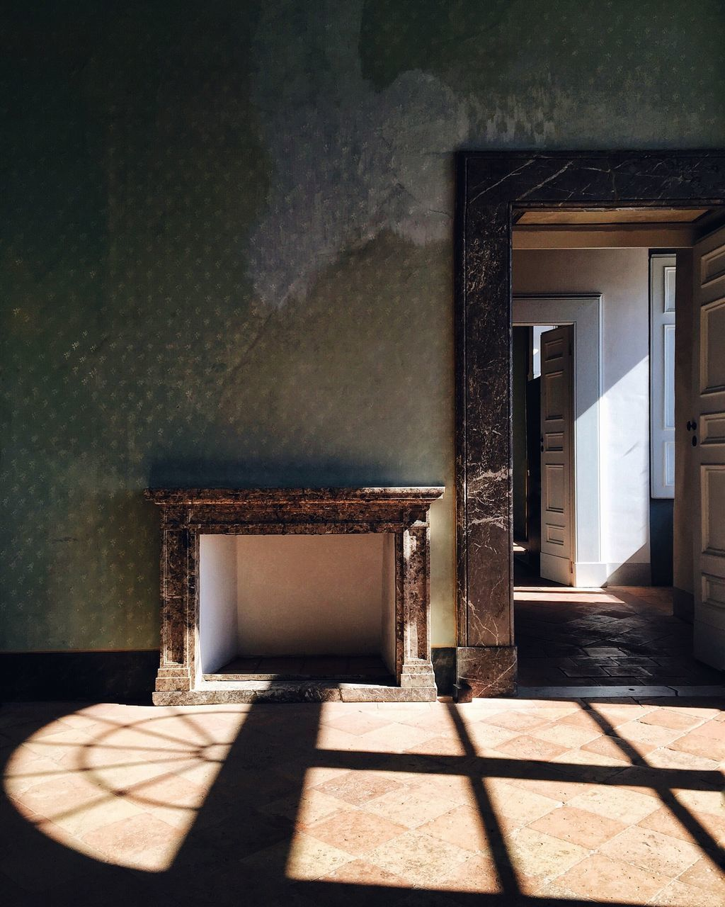 Shadow Of Window On Tiled Floor At Home