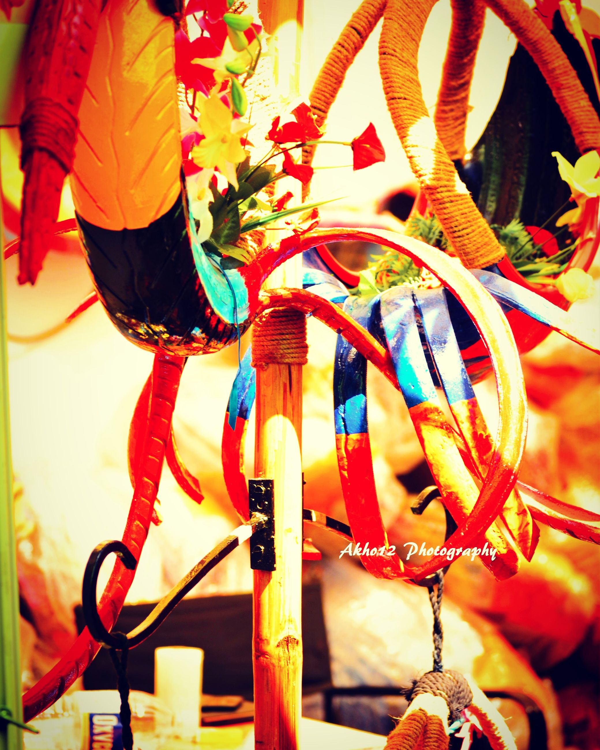 multi colored, low angle view, decoration, colorful, hanging, red, close-up, creativity, cultures, celebration, art and craft, art, no people, outdoors, day, orange color, tradition, flower, umbrella, flag
