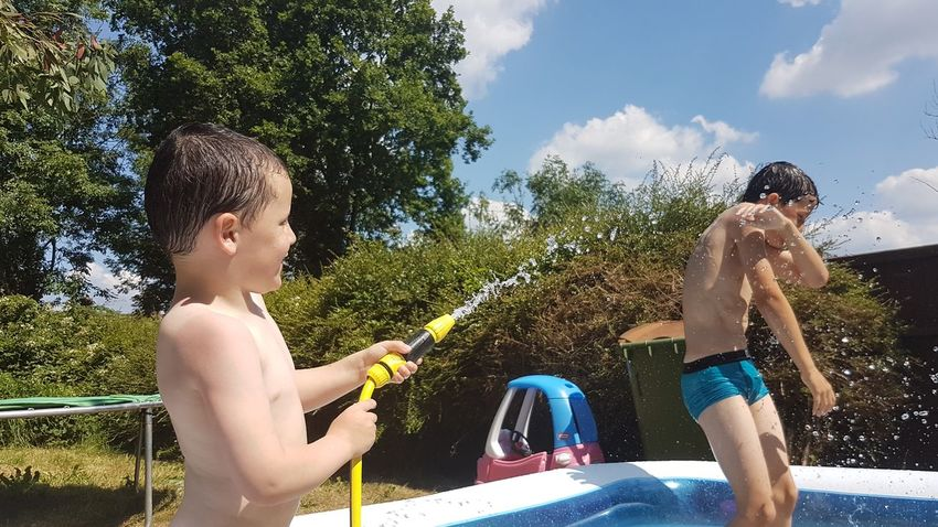 EyeEm Selects No Filters Or Effects Friendship Bonding My Boys Having Fun Hosepipe Spraying Water Summer Pool Laughter Messing Around