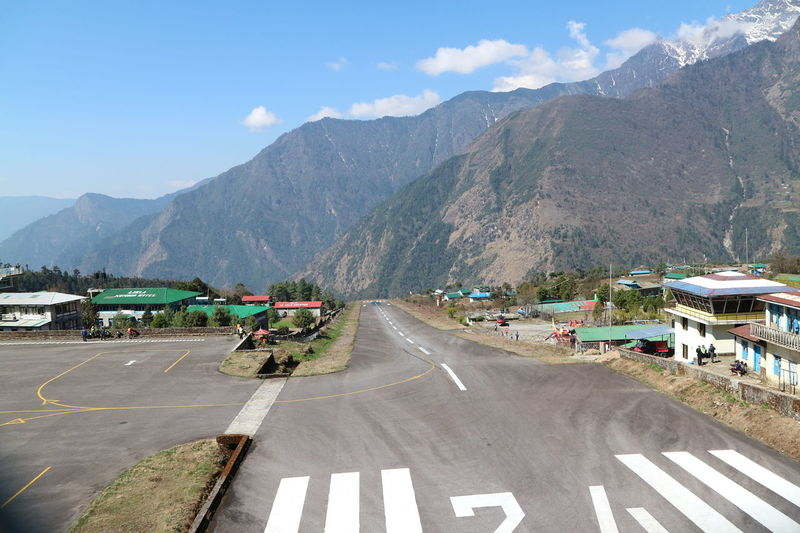 The runway at Lukla airport Airport Beauty In Nature Dangerous Day Everest Landscape Lukla Motorcycle Mountain Mountain Range Mountain Road Nature Nepal No People Outdoors Road Runway Sky The Way Forward Transportation Twin Otter