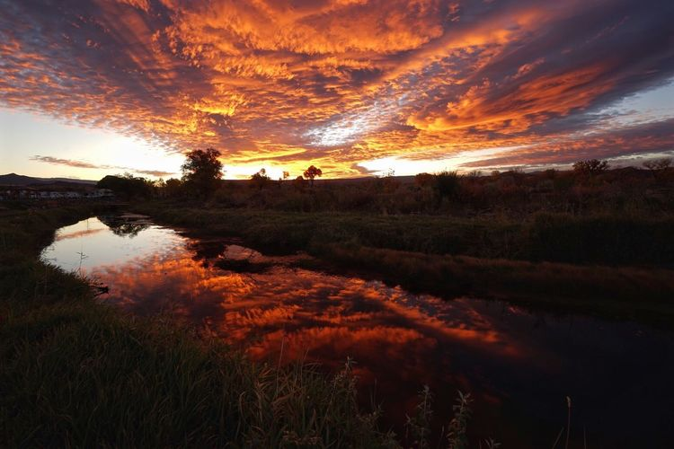 Light And Reflection Colorado Fall Sunrise Sunrise_sunsets_aroundworld Reflection Clouds And Sky Riverside River Landscape Nature Water Scenics Beauty In Nature Outdoors Multi Colored End Of Summer Nature Trees Tranquility Orange Color No People The Great Outdoors - 2018 EyeEm Awards