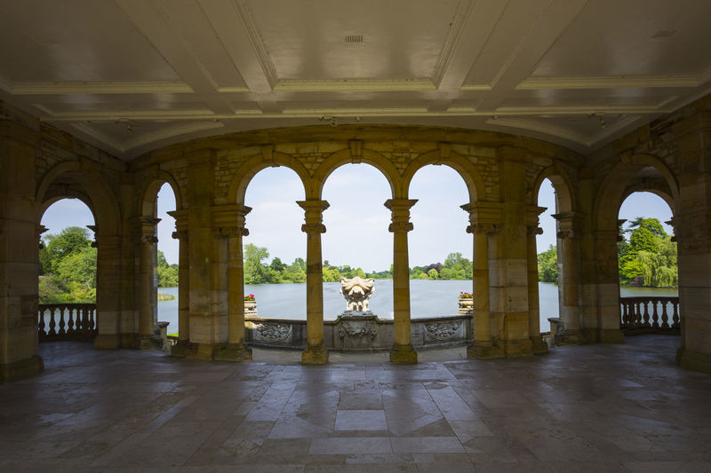 Hever Lake from the Loggia, Hever Castle & Gardens, Hever, Edenbridge, Kent, England, United Kingdom Ancient Arch Architectural Column Architecture Built Structure Day History Indoors  Nature No People Sky Tourism Travel Travel Destinations Water