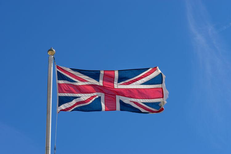Flag of the united kingdom union jack waving in a blue sky