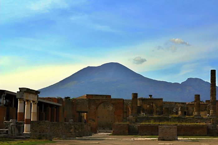 A view of the sleeping giant Vesuvio from a square of Pompeii, Italy. Historical Building Mediterranean  Pompeii  Tourist Vesuvio Architecture Building Exterior Built Structure Day Famous Place History History Architecture Italy Landmark Mountain Nature No People Outdoors Roman Sky Tourism Tourism Destination Travel Destinations Volcanic Landscape Volcano