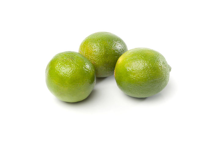 Three green fresh limes, fruit healthy food isolated on white background Citrus Fruit Close-up Cut Out Food Freshness Fruit Green Green Color Healthy Eating Juicy Lime No People Ripe Still Life Studio Shot Three White Background