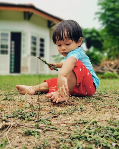 Cute boy playing on land