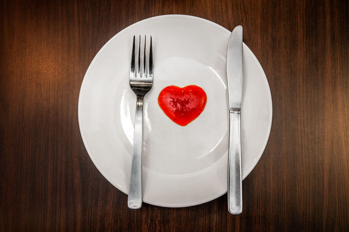 Fork, knife with heart shaped chilli sauce on white plate and placed on wooden tabletop. Chili Sauce Silverware  Close-up Cutlery Directly Above Eating Utensil Empty Plate Fork Fork And Knife Heart Shape Indoors  No People Plate Red Table Top View White Plate Wooden Tabletop Food Stories The Still Life Photographer - 2018 EyeEm Awards