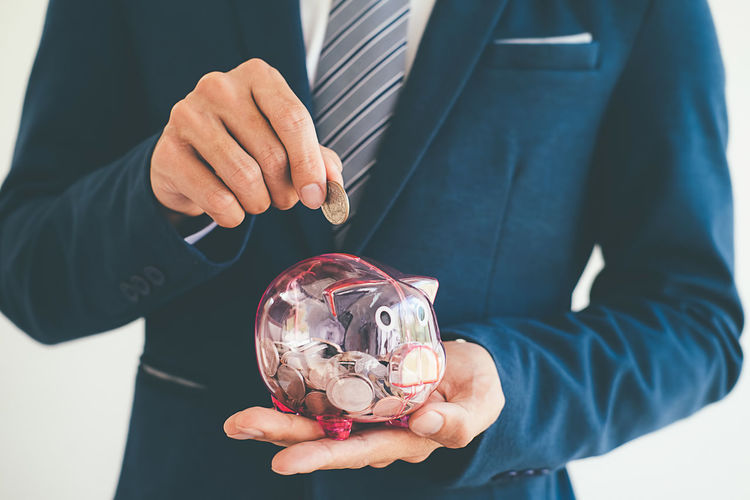 Childhood Close-up Coin Day Finance Holding Human Body Part Human Hand Men Midsection One Person Outdoors Piggy Bank Real People Savings Standing Technology