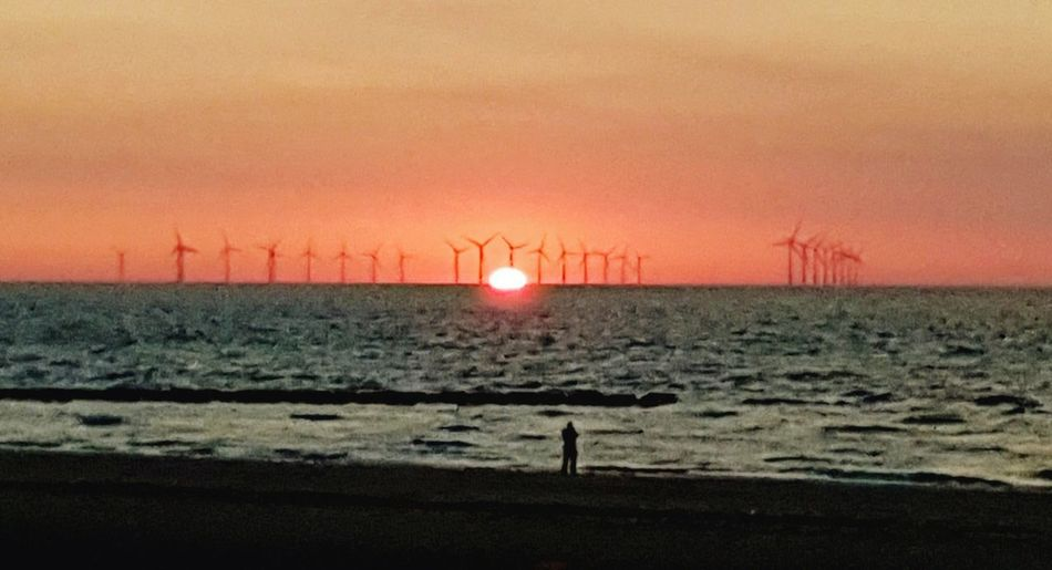 sun setting over Liverpool bay. Scenics - Nature Scenary Silhouette Seascape Beach Nature New Brighton Wirralcountrypark Wirral Peninsula Wirral Wirral Weather Wind Turbine Wind Power Technology Sunset Industry Alternative Energy Sustainable Resources Electricity