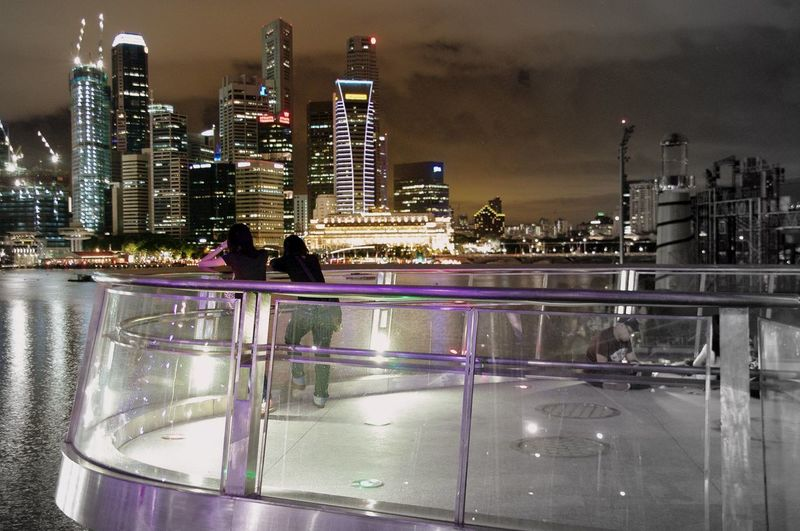Night stroll around Marina Bay playing with my Pentax K20d, 2010 Architecture Bridge - Man Made Structure Building Exterior Building Story Built Structure City City Life Cityscape Development Financial District  Growth Illuminated Modern Multi Colored Night Office Building Outdoors River Sky Skyscraper Tall Tall - High Urban Skyline Water Waterfront