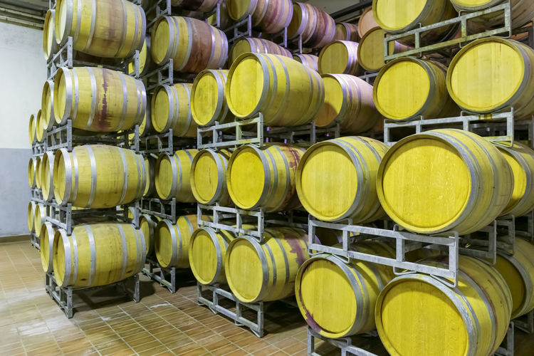 Metal silos for the fermentation of wine inside a farm. storage of wine in the cellar