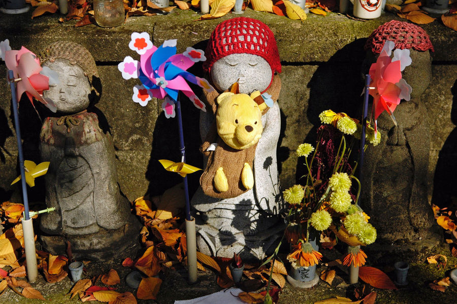 Ornately decorated ojizosama statue to protect children in the afterlife. Cemetary Childhood Close-up Culture Cultures Decoration Japan Japanese Culture Japanese Style Ojizosama Red Remembering Remembrance Statue Tokyo Ultimate Japan