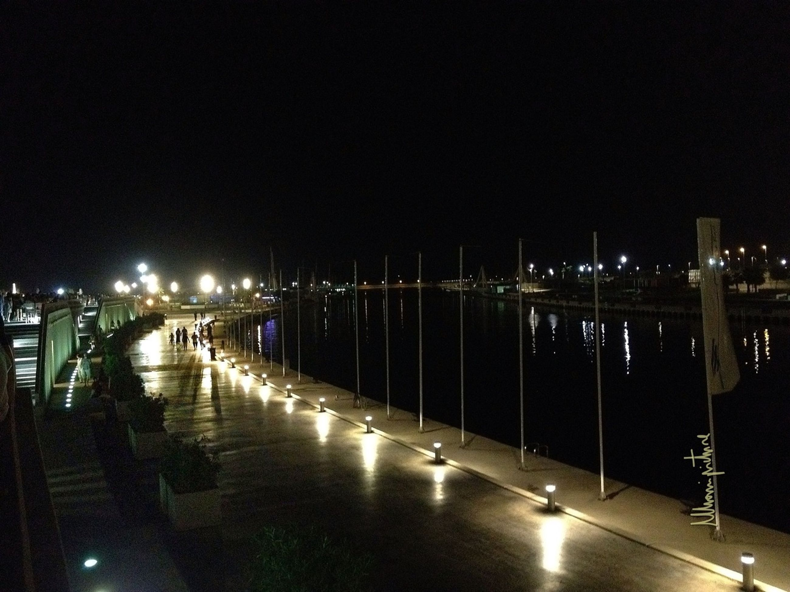 night, illuminated, water, reflection, built structure, architecture, river, lighting equipment, city, transportation, street light, copy space, clear sky, waterfront, sea, building exterior, bridge - man made structure, nautical vessel, sky, dark