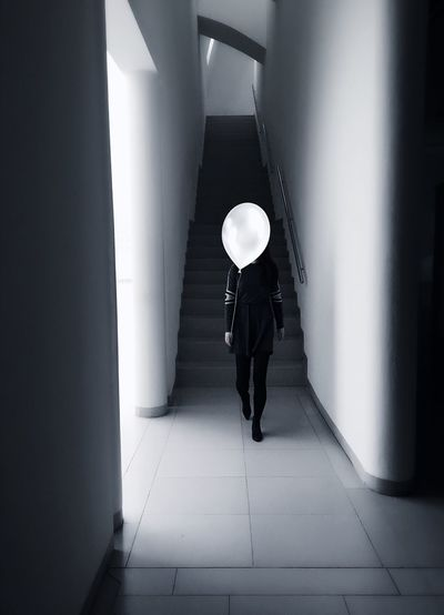 Woman Woman Portrait Real People Hide Balloon Blackandwhite ThatsMe Indoors  Walking Lifestyles Built Structure Architecture Day Hello World Enjoyinglife  Modern Daytime Welcome To Black Art Is Everywhere Black And White Friday