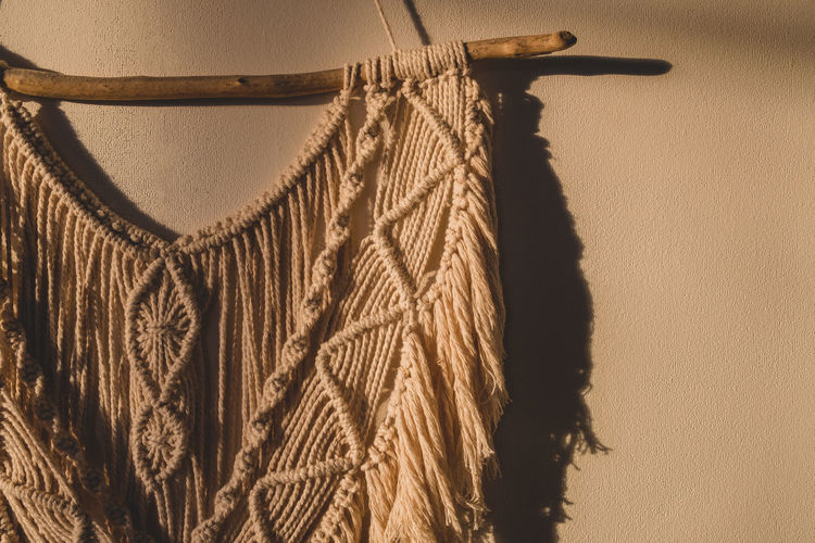 Close-up of rope against wall