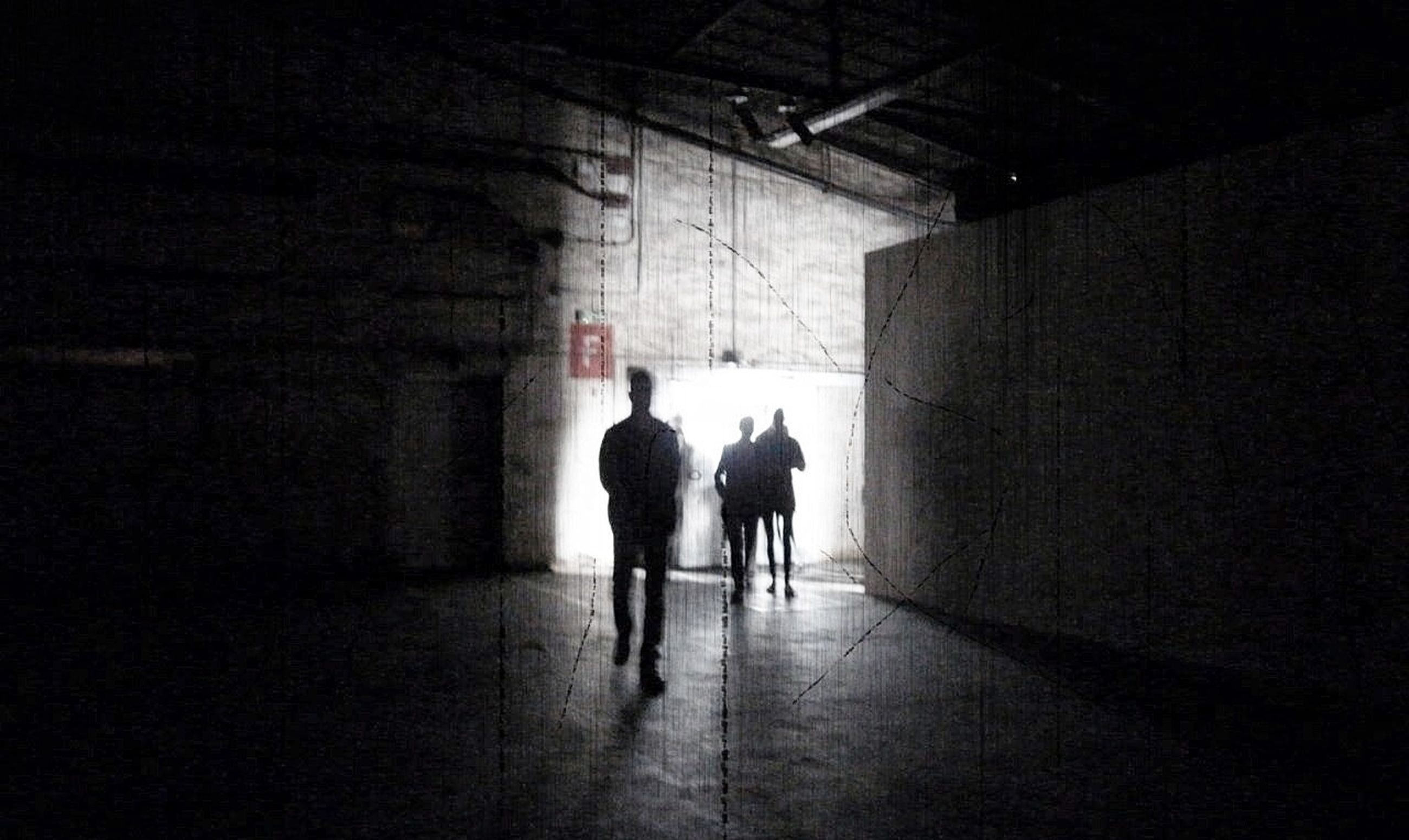 indoors, walking, full length, silhouette, rear view, men, architecture, lifestyles, built structure, corridor, the way forward, person, tunnel, wall - building feature, illuminated, dark, leisure activity