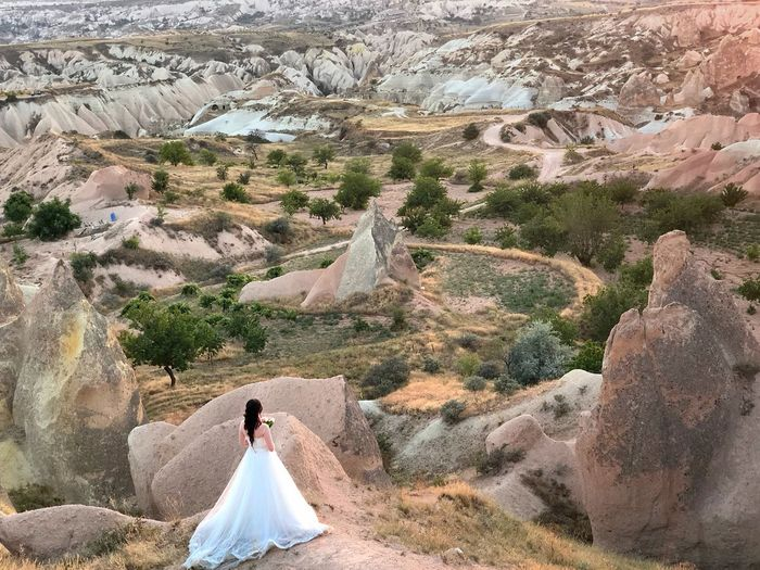 High angle view of bride standing on rock formation