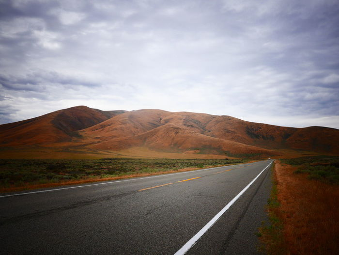 17.62° An Eye For Travel Driving Cloud - Sky Highway Landscape Lonelyplanet Mountain Mountain Range Non-urban Scene Outdoors Remote Road Road Marking Rural Scene The Way Forward Transportation Lost In The Landscape