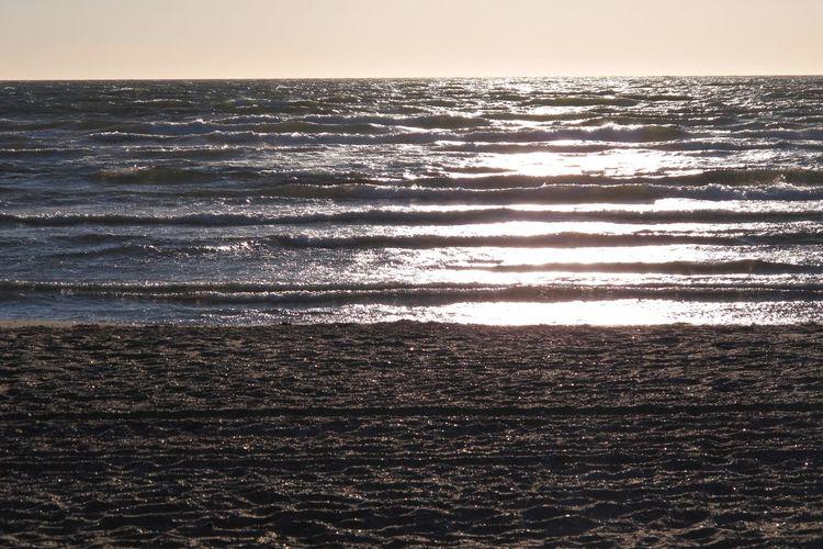 Beach Horizon Horizon Over Water Idyllic Land Motion Nature No People Outdoors Sea Sky Sunlight Sunset Tranquil Scene Tranquility Water Wave
